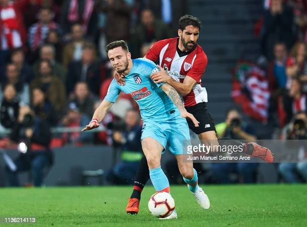 Saul Niguez of Atletico Madrid duels for the ball with Raul Garcia of Athletic Club during the La Liga match between Athletic Club and Club Atletico...