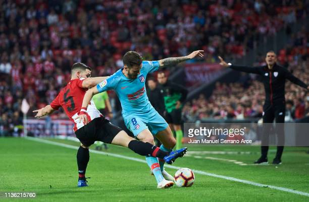 Saul Niguez of Atletico Madrid duels for the ball with Yerran Alvarez of Athletic Club during the La Liga match between Athletic Club and Club...