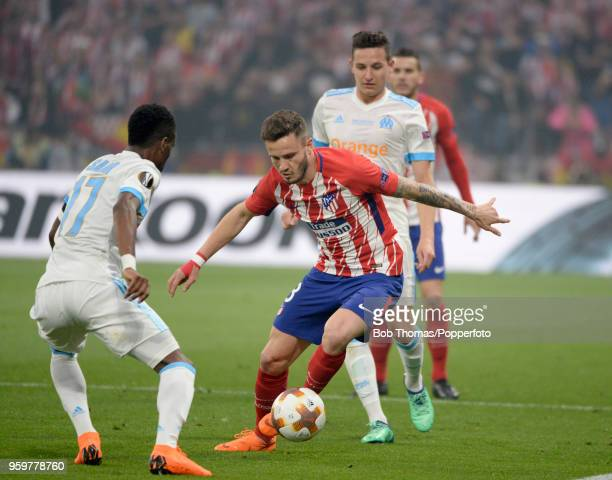 Saul Niguez of Atletico Madrid is challenged by Bouna Sarr of Marseille during the UEFA Europa League Final between Olympique de Marseille and Club...