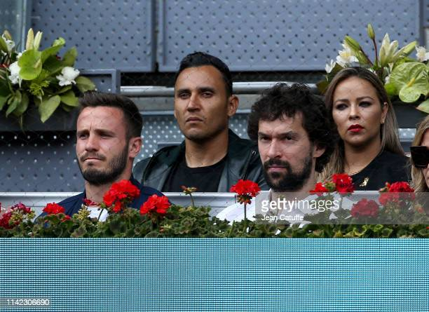 Saul Niguez of Atletico Madrid Keylor Navas of Real Madrid and his wife Andrea Salas Sergio Llull of Real Madrid Baloncesto attend the victory of...