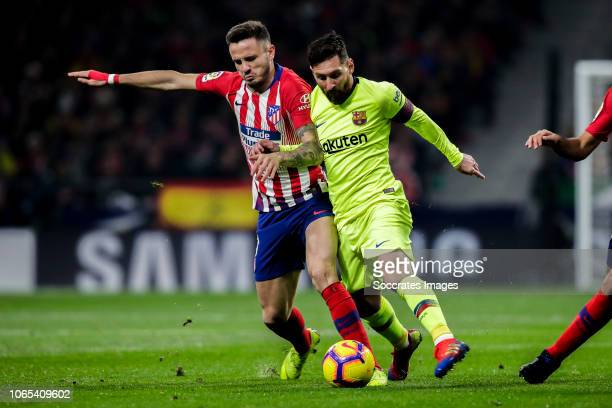 Saul Niguez of Atletico Madrid Lionel Messi of FC Barcelona during the La Liga Santander match between Atletico Madrid v FC Barcelona at the Estadio...