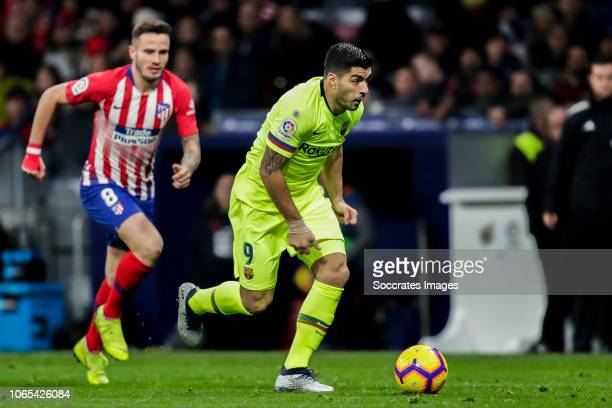 Saul Niguez of Atletico Madrid Luis Suarez of FC Barcelona during the La Liga Santander match between Atletico Madrid v FC Barcelona at the Estadio...