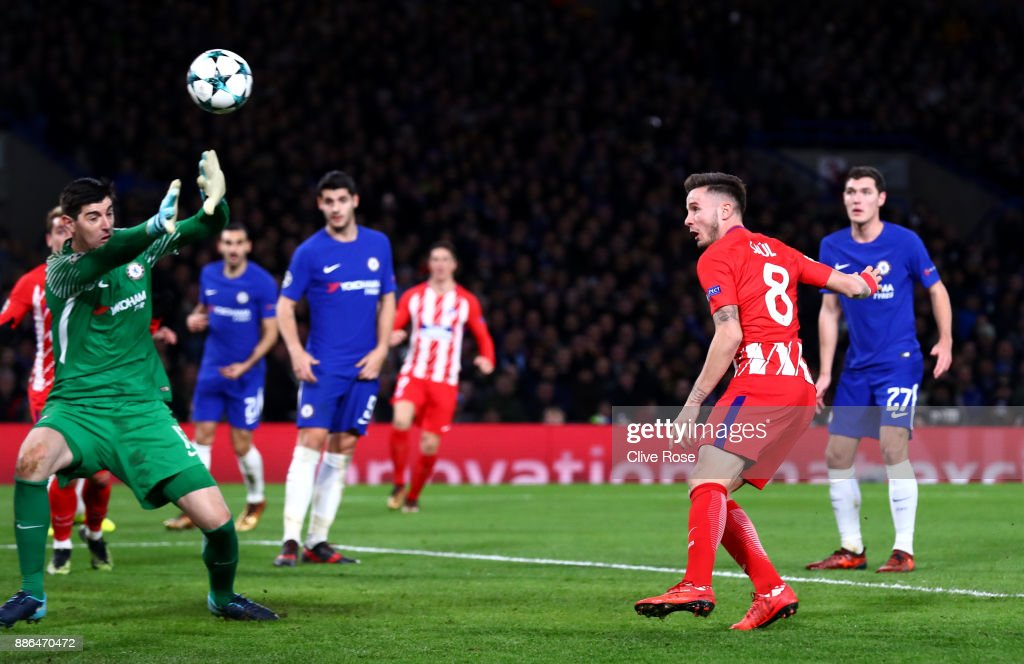 Saul Niguez of Atletico Madrid scores his sides first goal past Thibaut Courtois of Chelsea during the UEFA Champions League group C match between Chelsea FC and Atletico Madrid at Stamford Bridge on December 5, 2017 in London, United Kingdom.