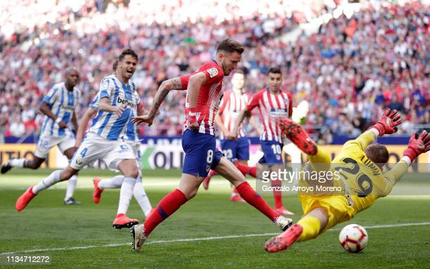 Saul Niguez of Atletico Madrid scores his team's first goal past Andriy Lunin of Leganes during the La Liga match between Club Atletico de Madrid and...