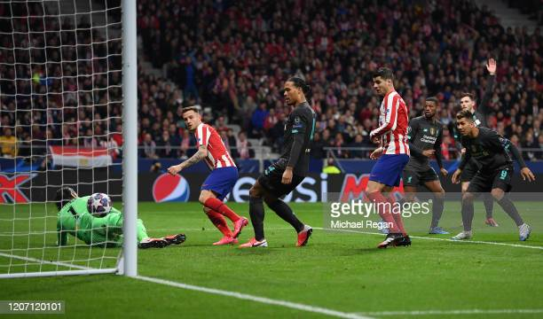 Saul Niguez of Atletico Madrid scores his team's first goal past Alisson Becker of Liverpool during the UEFA Champions League round of 16 first leg...