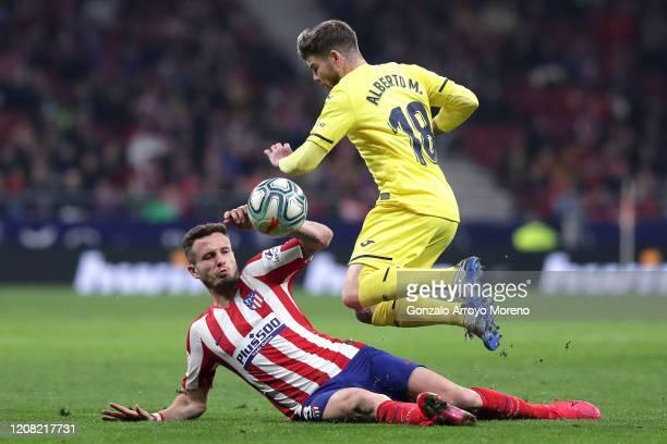 Saul Niguez of Atletico Madrid tackles Alberto Moreno of Villarreal during the La Liga match between Club Atletico de Madrid and Villarreal CF at...