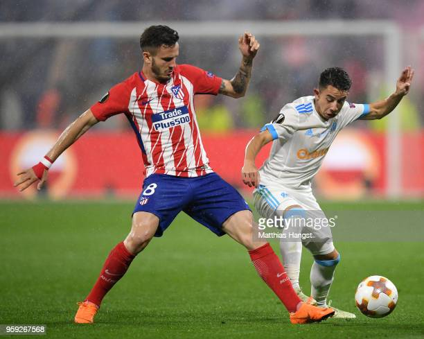 Saul Niguez of Atletico Madrid tackles Maxime Lopez of Marseille during the UEFA Europa League Final between Olympique de Marseille and Club Atletico...