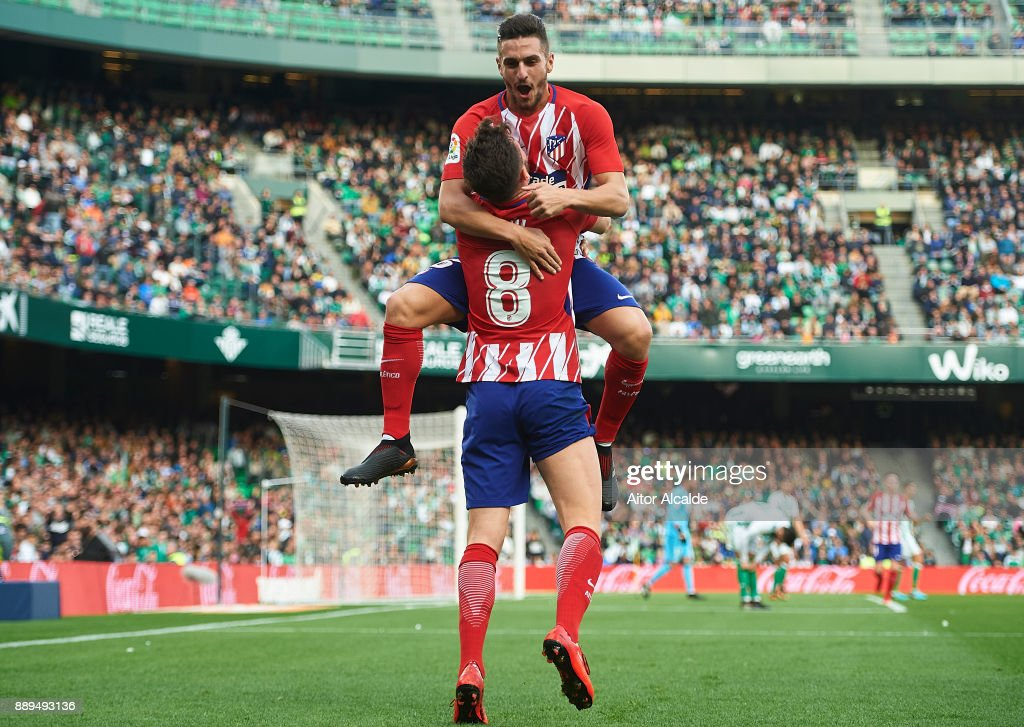 Saul Niguez of Club Atletico de Madrid celebrates after scoring the first goal for Club Atletico de Madrid withKoke Resurreccion of Club Atletico de Madrid during the La Liga match between Real Betis and Atletico Madrid at Estadio Benito Villamarin on December 10, 2017 in Seville, Spain.