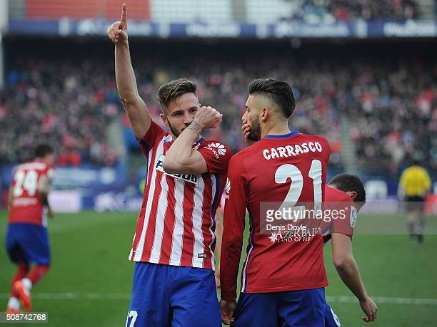 Saul Niguez of Club Atletico de Madrid celebrates with Yannick Carrasco after scoring his team's 2nd goal during the La Liga match between Club...