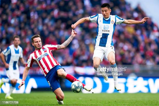 Saul Niguez of Club Atletico de Madrid competes for the ball with Wu Lei of RCD Espanyol during the Liga match between Club Atletico de Madrid and...