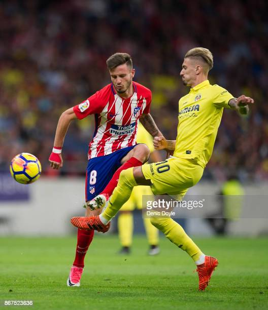 Saul Niguez of Club Atletico de Madrid is challenged by Samu Castillejo of Villarreal CF during the La Liga match between Atletico Madrid and...