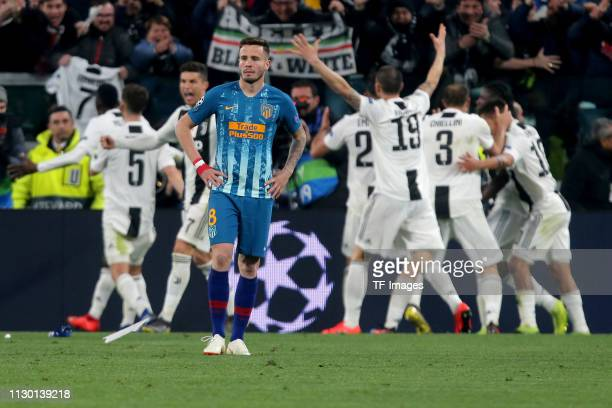 Saul Niguez of Club de Atletico Madrid looks dejected during the UEFA Champions League Round of 16 Second Leg match between Juventus and Club de...