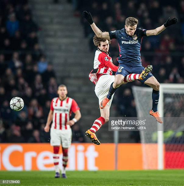 Saul Niguez of Madrid jumps for a header with Davy Proepper of Eindhoven during the UEFA Champions League Round of 16 First Leg match between PSV...