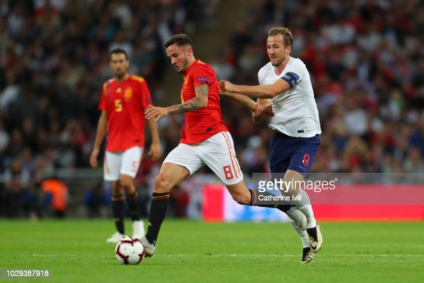 Saul Niguez of Spain and Harry Kane of England battle for the ball during the UEFA Nations League A group four match between England and Spain at...