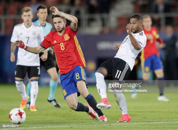 Saul Niguez of Spain and Serge Gnabry of Germany in action during the UEFA European Under21 Championship Final between Germany and Spain at Krakow...