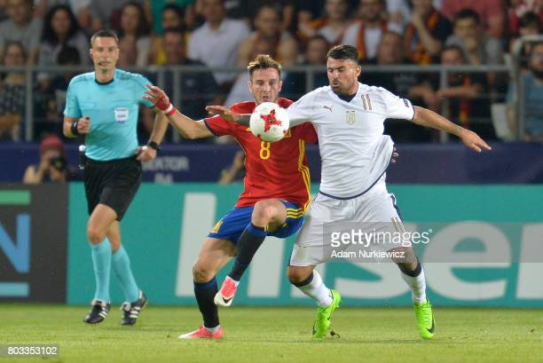 Saul Niguez of Spain challenges for the ball with Andrea Petagna of Italy during the UEFA European Under21 Championship Semi Final match between...