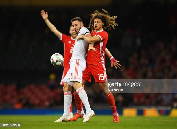Saul Niguez of Spain holds off Ethan Ampadu of Wales during the International Friendly match between Wales and Spain on October 11 2018 in Cardiff...