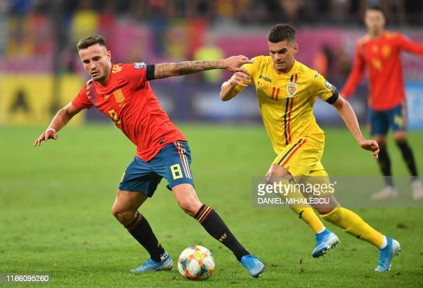 Saul Niguez of Spain vies for the ball with Romania's forward Ianis Hagi during the Euro 2020 football qualification match between Romania and Spain...