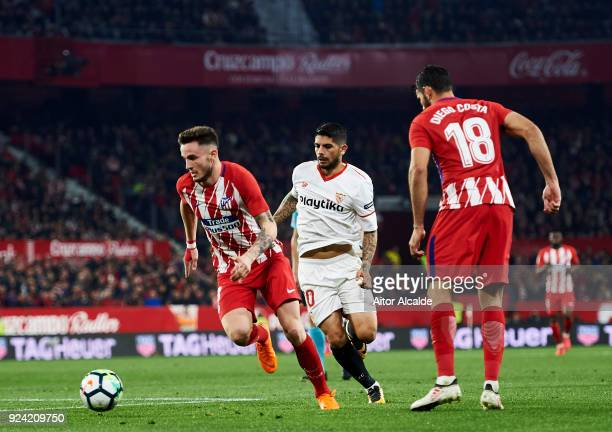 Saul Niguiz of Atletico Madrid competes for the ball with Ever Banega of Sevilla CF during the La Liga match between Sevilla CF and Atletico Madrid...