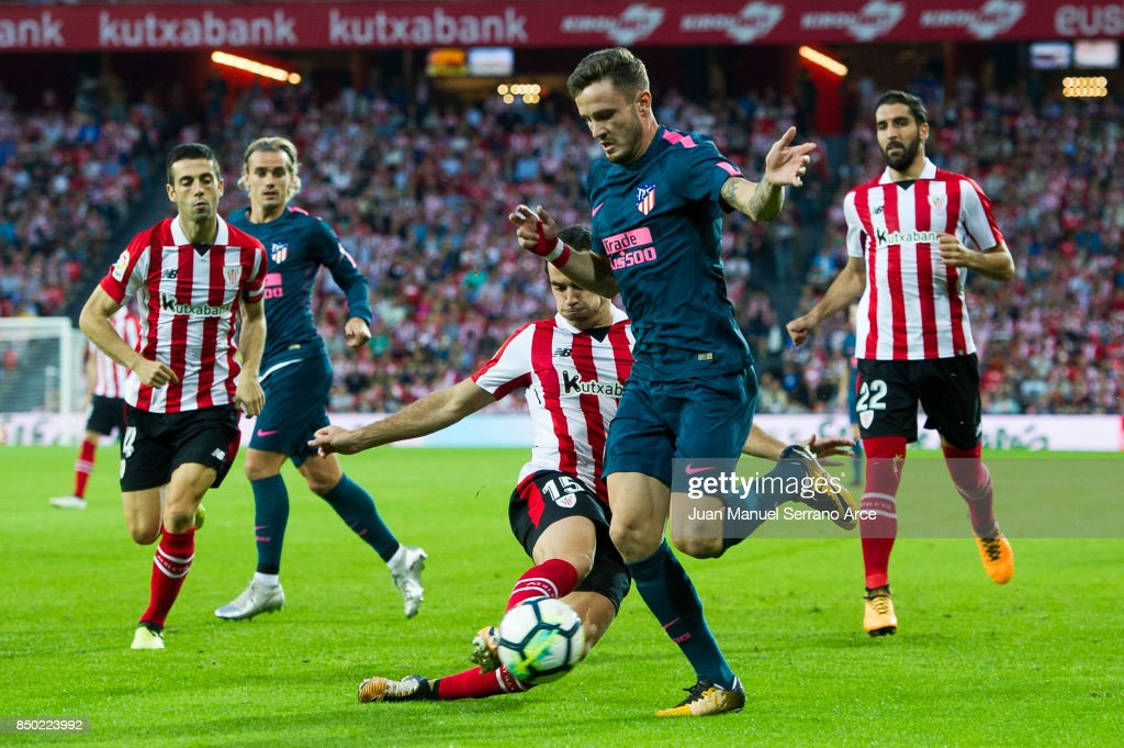Saul Niguiz of Atletico Madrid competes for the ball with Unai Nunez of Athletic Club during the La Liga match between Athletic Club and Atletico Madrid at on September 20, 2017 in Bilbao, Spain.