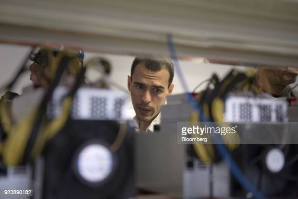 Saul Osio member of the United Socialist Party of Venezuela and cryptocurrencies specialist inspects mining rigs inside the cryptocurrency mining...