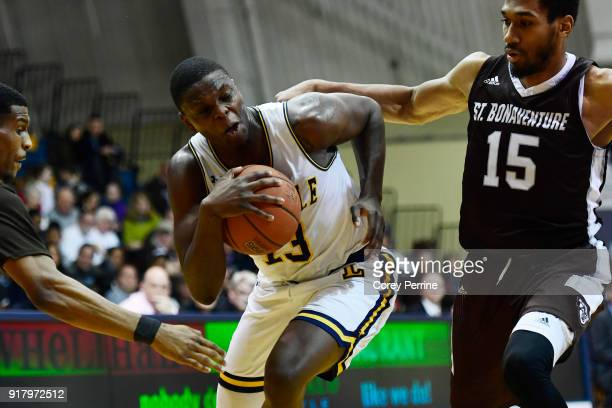 Saul Phiri of the La Salle Explorers is fouled by LaDarien Griffin as teammate Idris Taqqee of the St Bonaventure Bonnies pressures during the second...