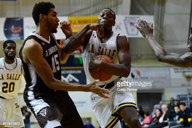 Saul Phiri of the La Salle Explorers is fouled by LaDarien Griffin of the St Bonaventure Bonnies during the second half at Tom Gola Arena on February...