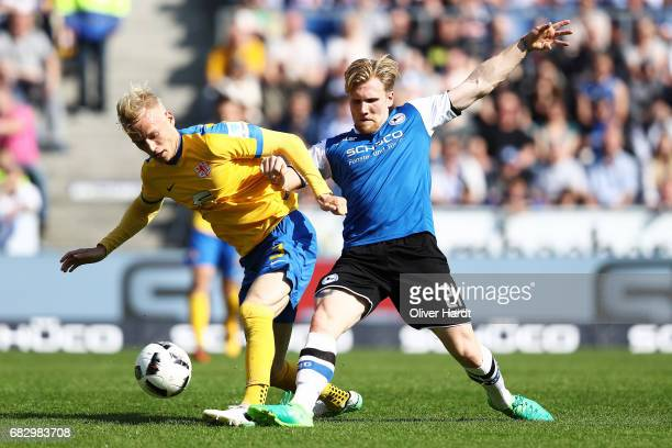 Saulo Igor Decarli of Bremen and Andreas Voglsammer of Hoffenheim compete for the ball during the Bundesliga match between Werder Bremen and TSG 1899...