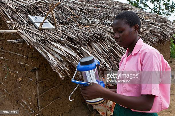 Saumu has a solar light fitted in her house to help her study Wema has supplied about 100 solar lights to students of Mari Mani School The school is...