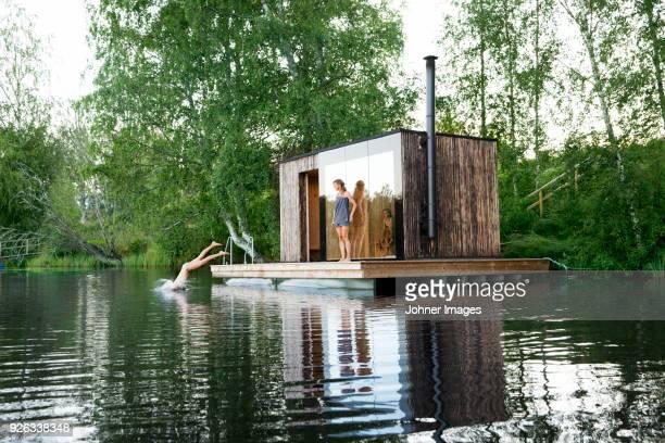 sauna at lake - sauna stock-fotos und bilder