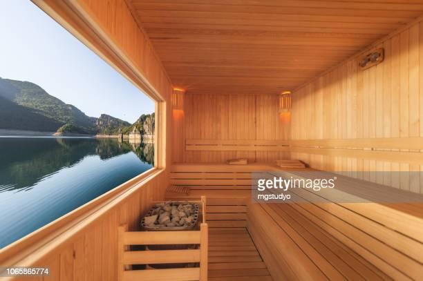 sauna mit blick auf berg und see - sauna stock-fotos und bilder