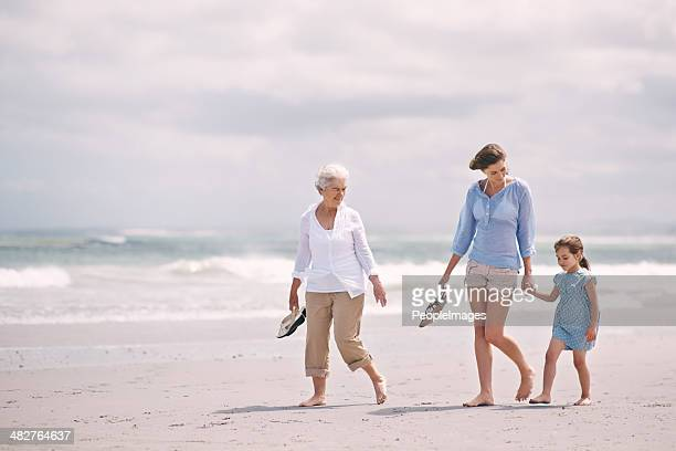 sauntering across the sand - beautiful granny stock photos and pictures