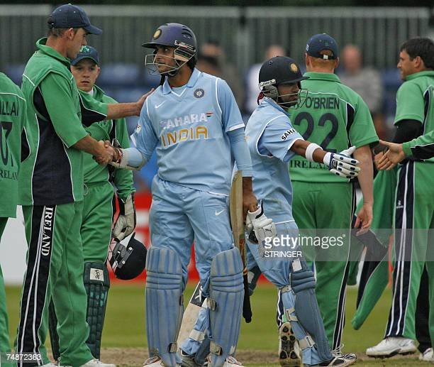Saurav Ganguly of India is congratulated 23 June 2007 by Irish captian Trent Johnson during the One Day International match at Stormont cricket...