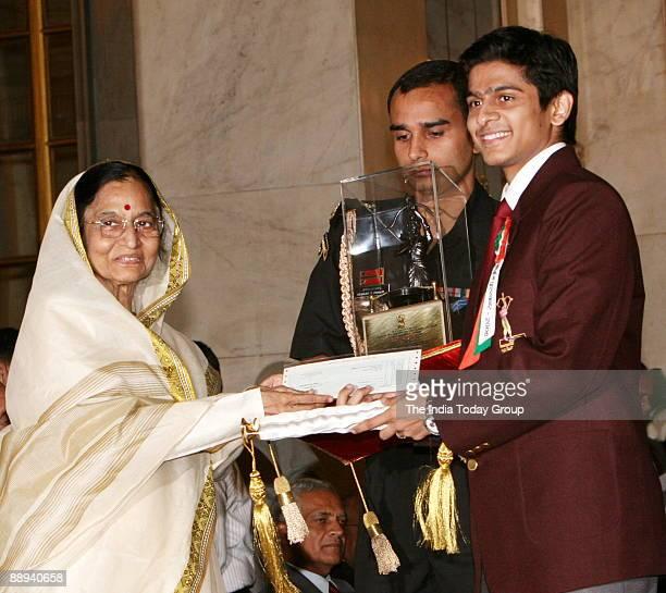 Saurav Ghosal Squash Player Receiving the Arjuna award from Pratibha Devisingh Patil President of India in New Delhi India