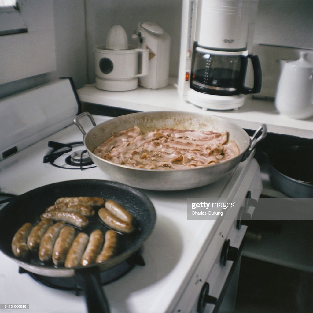 Sausage and Bacon Frying : Stock Photo