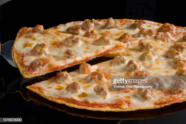 sausage and cheese thin crust pizza -  firak stock pictures, royalty-free photos & images