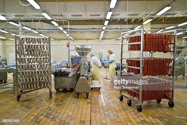 sausage manufacturing at slaughterhouse - meat processing plant stock pictures, royalty-free photos & images