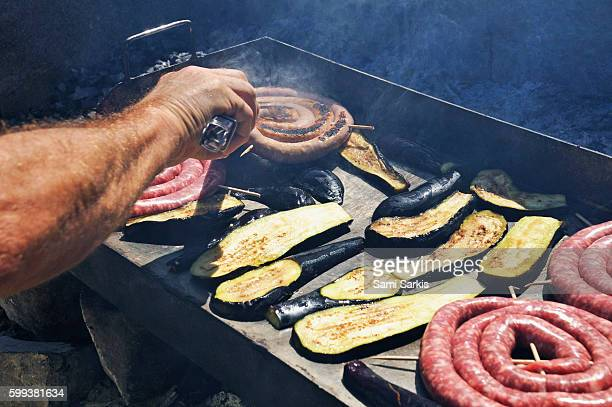 Sausages and eggplants / avocado on a BBQ