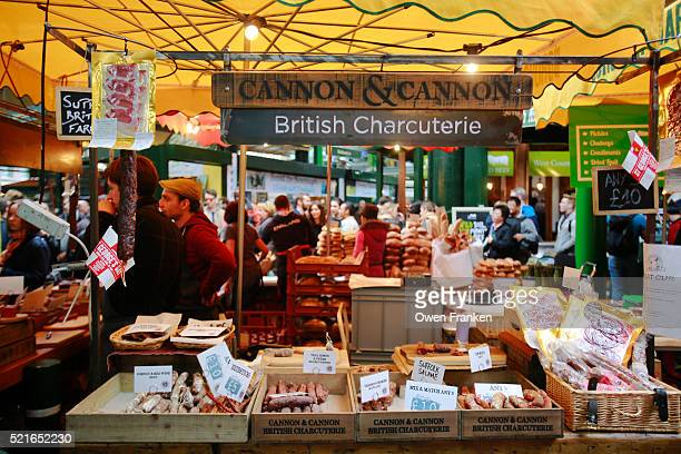 sausages and other preserved cured meats, in borough market, london - borough market stock pictures, royalty-free photos & images