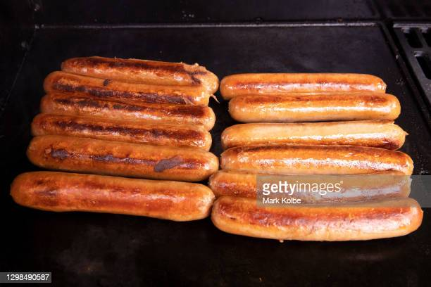 Sausages are seen cooking on a BBQ on January 26, 2021 in Sydney, Australia. Australia Day, formerly known as Foundation Day, is the official...