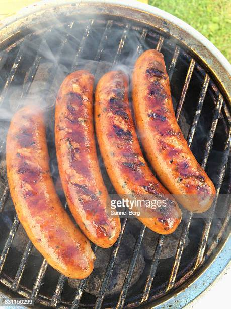 Sausages cooking on a barbecue grill