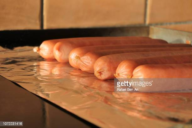 sausages frying on bbq grill - rafael ben ari stock pictures, royalty-free photos & images