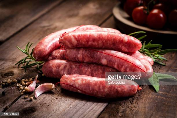 Sausages heap on dark wood table