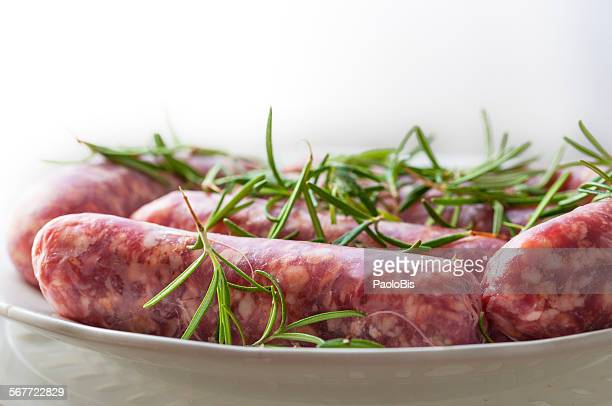 Sausages ready to cook flavored with rosemary