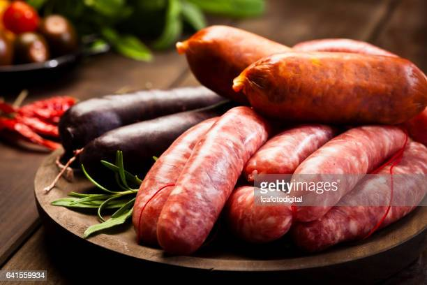 Sausages variation on dark wood table