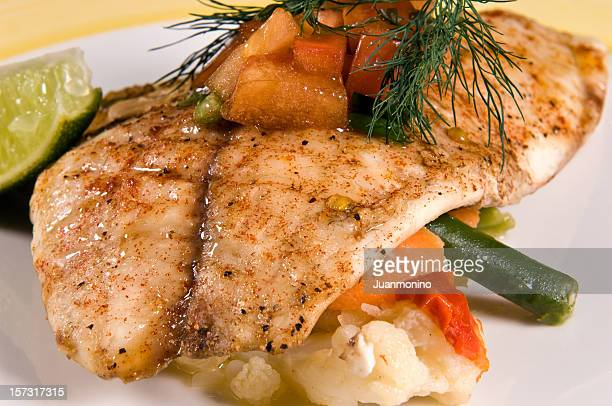 saute fillet of tilapia - seared stock photos and pictures