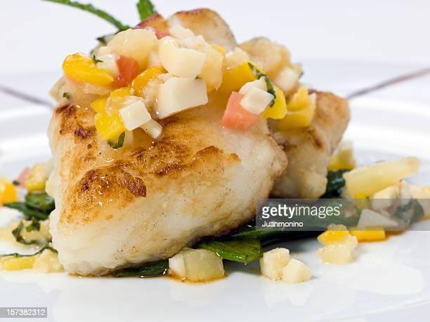 saute sea bass with mango-tropical fruits sauce - course meal stockfoto's en -beelden