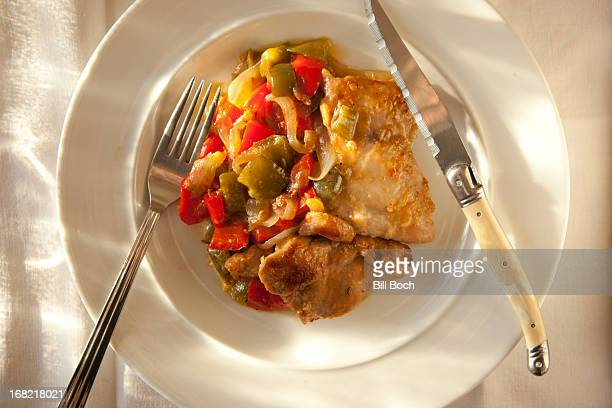 Sauted chicken thighs onions and peppers