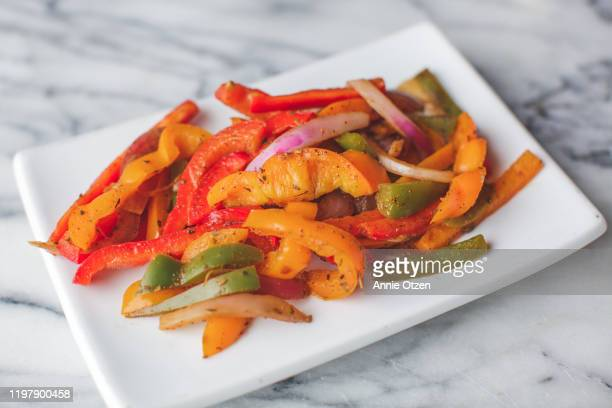sautéed peppers and onion fajita vegetables - pepper vegetable stock pictures, royalty-free photos & images