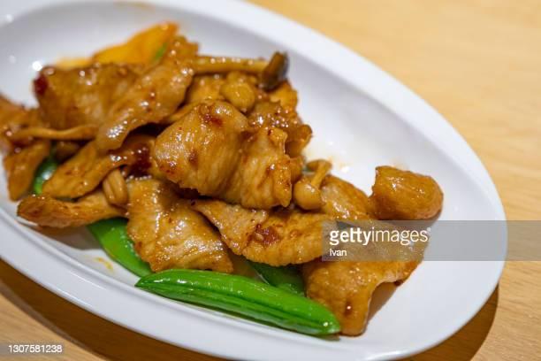 sauteed pork tenderloin in asian style - 煮物 ストックフォトと画像